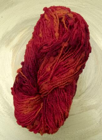 Blickfang Feuervogel | Atelier Zitron | Boucletgarn aus 100% Merino extrafein | tolles Farbenspiel | © Die Maschen zum Glück